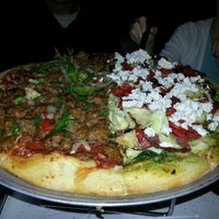 Photo taken at Flying Pie Pizzeria by Weston R. on 9/10/2012