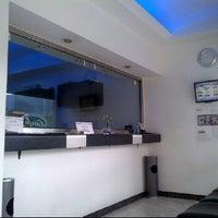Photo taken at El condor Cambios y Divisas Ltda. by David M. on 3/11/2012