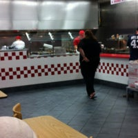 Photo taken at Five Guys by Katie P. on 5/18/2012