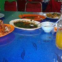 Photo taken at Kepiting Saos Super Kenari by echy d. on 5/14/2012