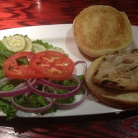 Photo taken at Red Robin Gourmet Burgers by Samira I. on 9/3/2012