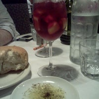 Photo taken at Romano's Macaroni Grill by Mary Kate S. on 9/3/2011