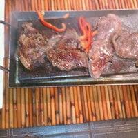 Photo taken at Mompou Tapas Bar & Lounge by Helena N. on 8/10/2011