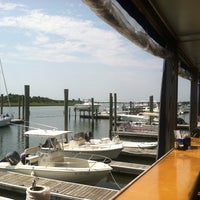 Photo taken at Dockside Restaurant & Bar by KC W. on 8/17/2011