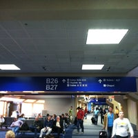 Photo taken at Gate B26 by Mike K. on 10/28/2011