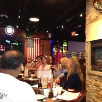 Photo taken at Rusty Bucket Restaurant and Tavern by Donna B. on 6/22/2012