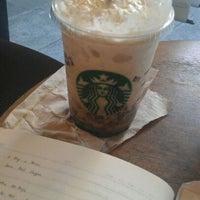 Photo taken at Starbucks Coffee by Melanie R. on 12/3/2011