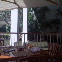 Photo taken at Naupaka Terrace by Nadine B. on 8/26/2011