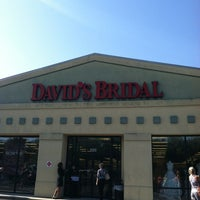 Photo taken at David's Bridal by Sara B. on 5/5/2012