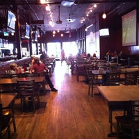 Photo taken at Gusano's Chicago Style Pizzeria & Sports Bar by Kale G. on 7/31/2011