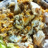 Photo taken at The Halal Guys by Megan D. on 4/27/2012
