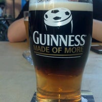 Photo taken at Rúla Búla Irish Pub and Restaurant by Travis M. on 6/18/2012