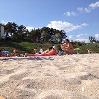 Photo taken at Plaja Neptun by Mihai O. on 8/19/2012