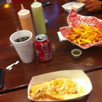 Photo taken at Los Perros by Alejandro M. on 7/28/2012