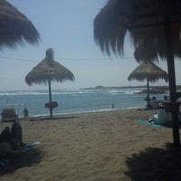 Photo taken at Tuto Beach by Andrea H. on 3/24/2012