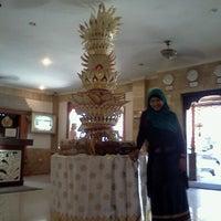 Photo taken at Poolside Wina Holiday Inn Kuta Bali by Anik D. on 9/2/2012