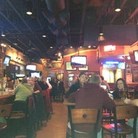 Photo taken at Boston's Restaurant & Sports Bar by Kirstin R. on 3/10/2012