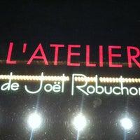 Photo taken at L'Atelier de Joël Robuchon by Olga R. on 5/21/2012