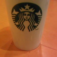Photo taken at Starbucks by Kenisha H. on 8/4/2012