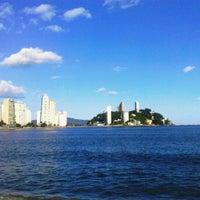 Photo taken at Praia do Gonzaguinha by Debora E. on 5/1/2012