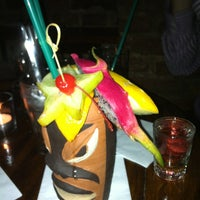 Photo taken at Aloha Coctail & Music Club by Kate K. on 6/21/2012