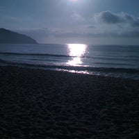 Photo taken at Praia Martim de Sá by Luciano G. on 2/18/2012