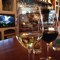 Photo taken at The Tangled Vine Wine Bar & Kitchen by Marie D. on 4/5/2012