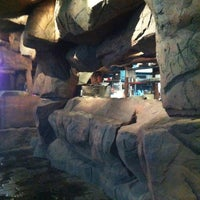 Photo taken at Dino Park Mini Golf by Ирина Л. on 3/26/2012