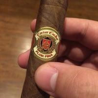 Photo taken at Fume Cigar Shop & Lounge by Timothy P. on 7/8/2015