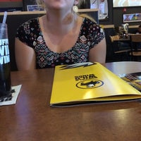 Photo taken at Buffalo Wild Wings by Caitlyn J. on 12/9/2014