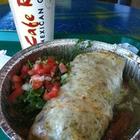 Photo taken at Cafe Rio Mexican Grill by Eric T. on 10/24/2013