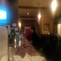 Photo taken at Suparossa Ristorante Italiano and Pizzaria by Rick E F. on 11/16/2013