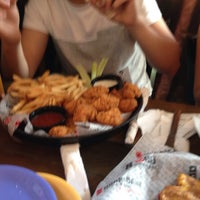 Photo taken at Hurricane Grill And Wings by Betty N. on 3/16/2015