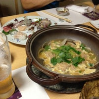 Photo taken at 魚屋 小次朗 by Nao on 10/8/2013