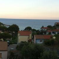Photo taken at Spiaggia Seccheto by Maurizio O. on 8/17/2013