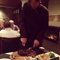 Photo taken at Trib Steakhouse by Dave C. on 8/13/2014