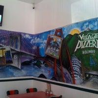 Photo taken at Village Pizzeria by Village Pizzeria on 11/10/2014