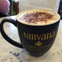 Photo taken at Nirvana Coffee Company by Adrian H. on 4/20/2015