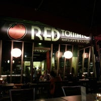 Photo taken at Red Tomato Restaurant & Lounge by John W. on 11/27/2012