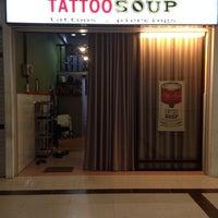 Photo taken at Tattoo Soup Tattoos & Piercing Studio, Merdeka Mall by Josephine M. on 1/24/2014