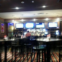 Photo taken at Coaches Sports Bar & Grill by Tamiko P. on 10/14/2012