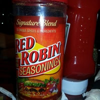 Photo taken at Red Robin Gourmet Burgers by Megan B. on 7/28/2013