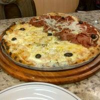Photo taken at Patroni Pizza by Gabriel N. on 4/6/2013