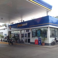 Photo taken at Gasolinera uno by Tania E. on 6/21/2014