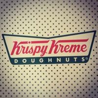 Photo taken at Krispy Kreme Doughnuts by Kara B. on 7/15/2013