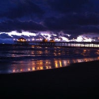 Photo taken at Huntington Beach Pier by Lacy P. on 3/10/2013