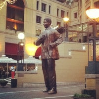 Photo taken at Nelson Mandela Square by Michael G. on 11/2/2012