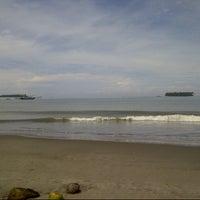 Photo taken at Pantai Gandoriah Pariaman by Zul L. on 9/9/2013