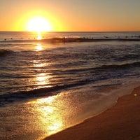 Photo taken at Scarborough Beach by Tyler G. on 5/24/2013