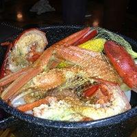 Photo taken at Joe's Crab Shack by Erika S. on 3/5/2013